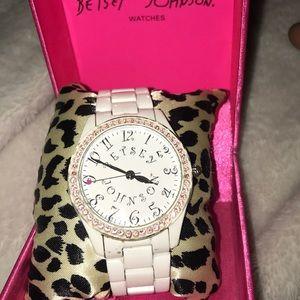 White with pink rhinestones Betsey Johnson watch.